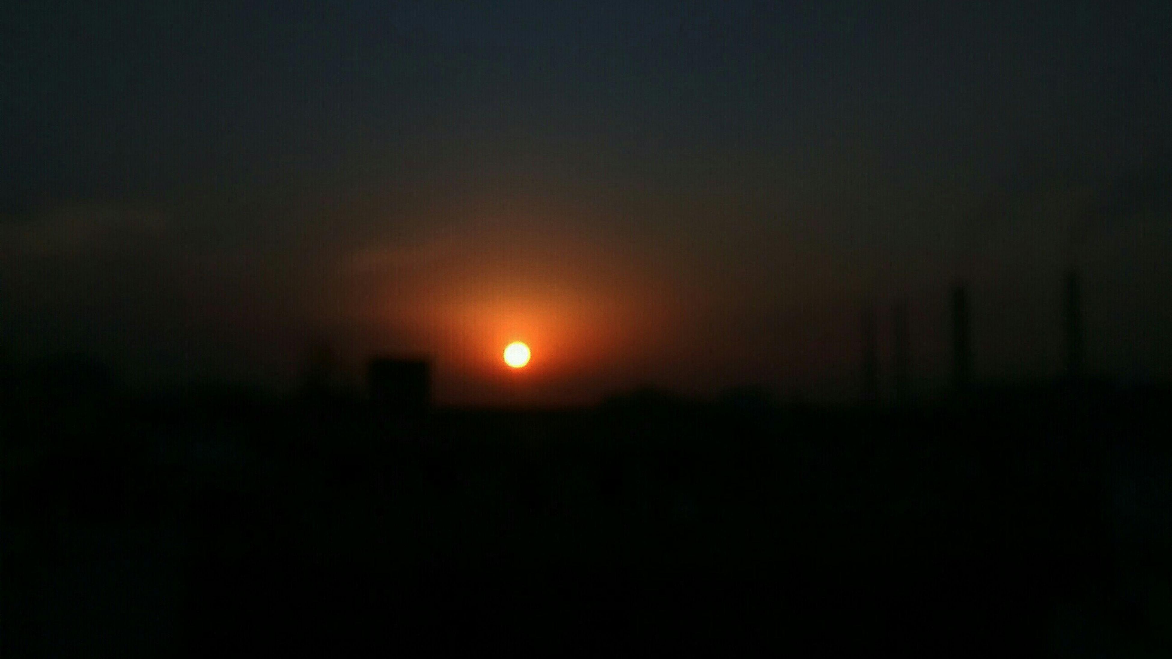 sunset, silhouette, scenics, dark, beauty in nature, copy space, tranquil scene, orange color, tranquility, sky, idyllic, nature, sun, landscape, outdoors, no people, night, majestic, dramatic sky, dusk