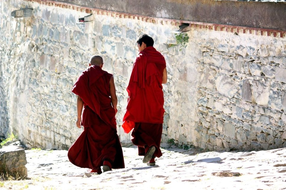 Monks at Ta Shi Lhun Po Monastery in Shigatse, Tibet ASIA Buddhist Monks From Behind Monks Red Clothes Spirituality Tibet Tibetan Buddhism Travel Photography Walking