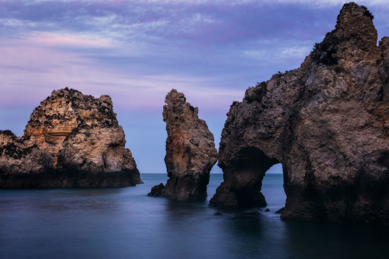 Rock Formation Rock - Object Natural Arch Nature Beauty In Nature Tranquility Scenics Waterfront Sky No People Sea Physical Geography Water Day Outdoors The Great Outdoors - 2017 EyeEm Awards Landscape Algarve Ponta Da Piedade Portugal Lagos Nature Rock Formation Beach Cliff