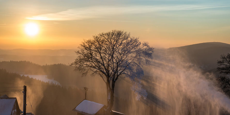 Bare Tree Beauty In Nature Day EyeEm Best Shots Landscape Mountain Nature No People Outdoors Sky Snow Snow Maker Sun Light Sunset Tree Weather Winter