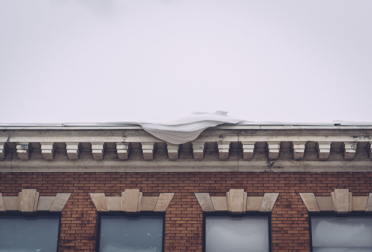 Architecture Building Exterior Building Exteriors Built Structure Day Hanging Snow Low Angle View No People Old Building  Outdoors Pile Of Snow Snowy Rooftop