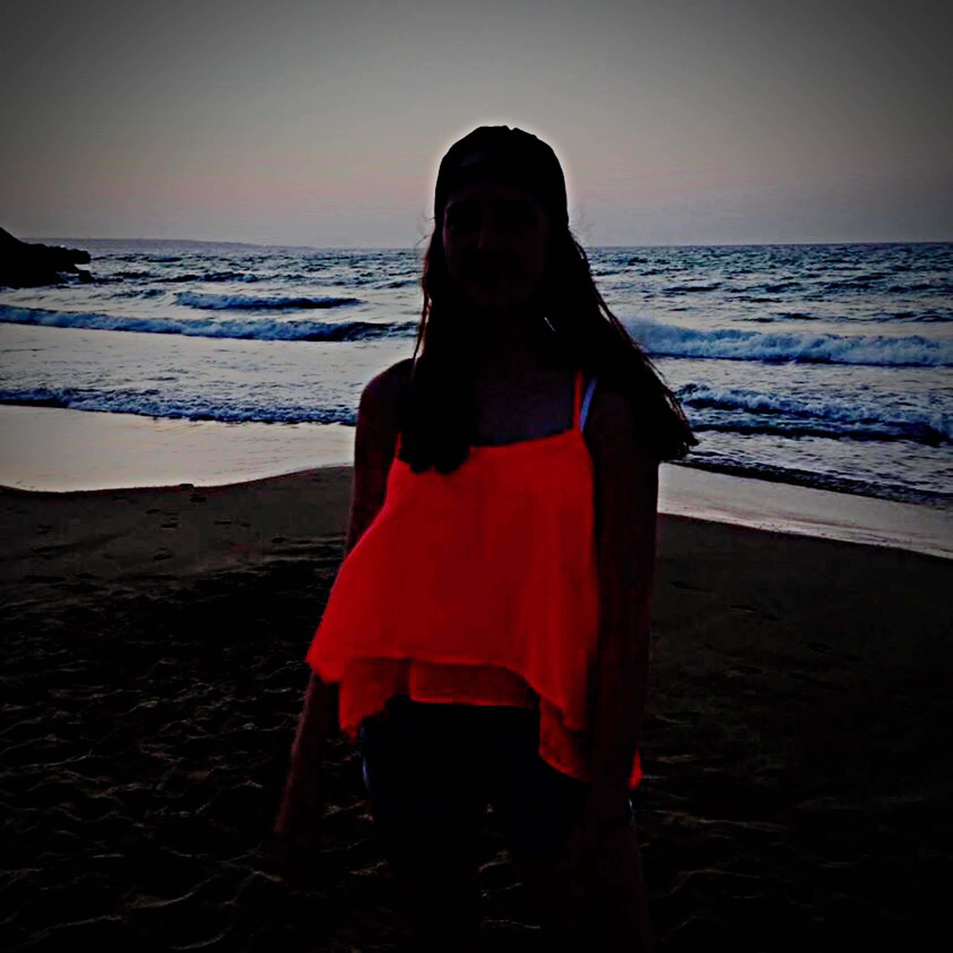 red, beach, one person, adults only, only women, people, sunset, adult, hood - clothing, one woman only, sea, silhouette, young adult, cape, outdoors, sky, one young woman only, day