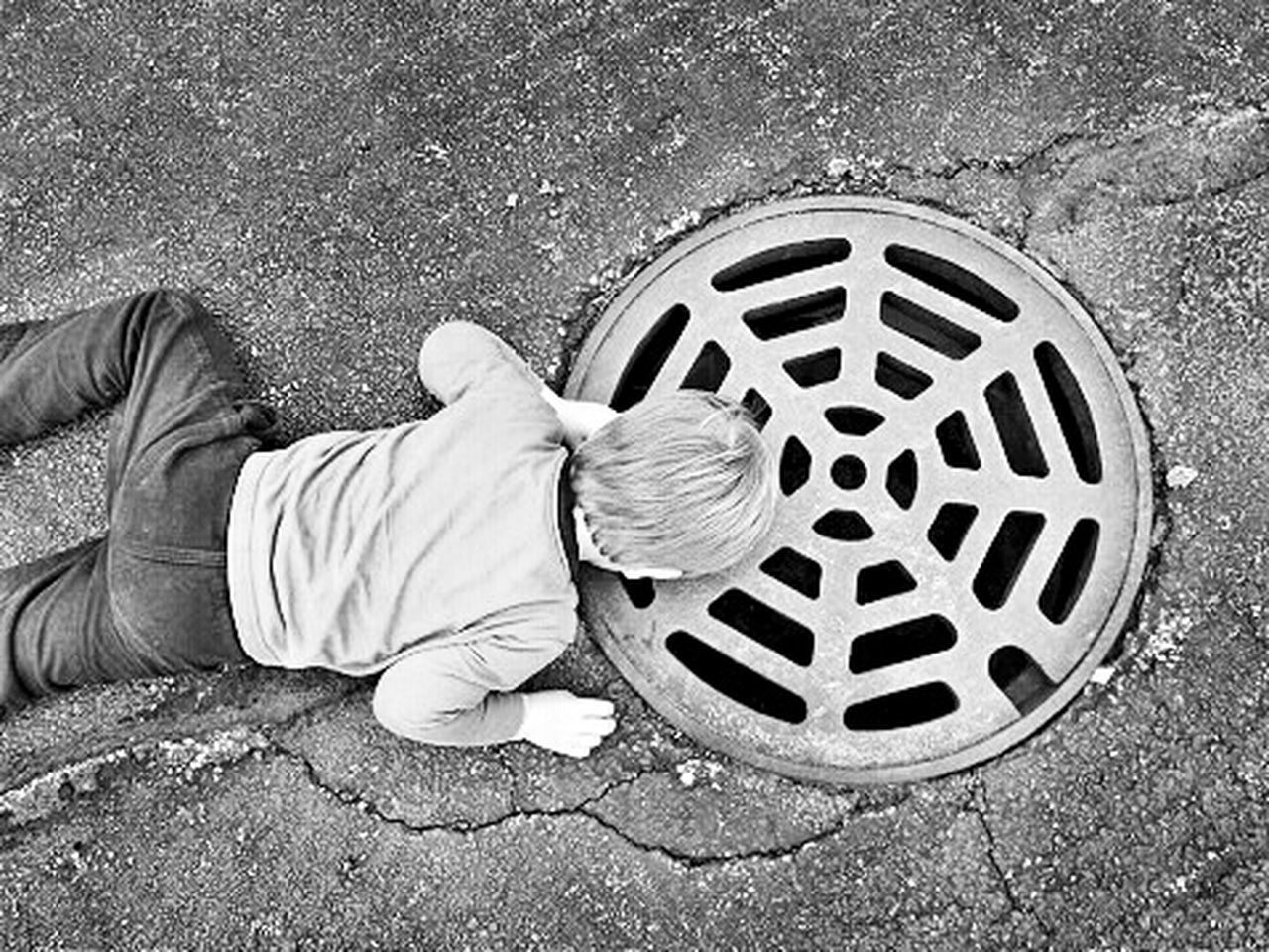 Boy looking in sewer Black And White Collection  Black&white Black And White Photography Blackandwhite Kids Children Children Photography Children's Portraits Childhood Memories Kids Playing Child Childhood Having Fun Learn Playing Boy Sewer Sewercover Sewer Drain Havingfun Wonder Black & White Black And White Exploring Explorer