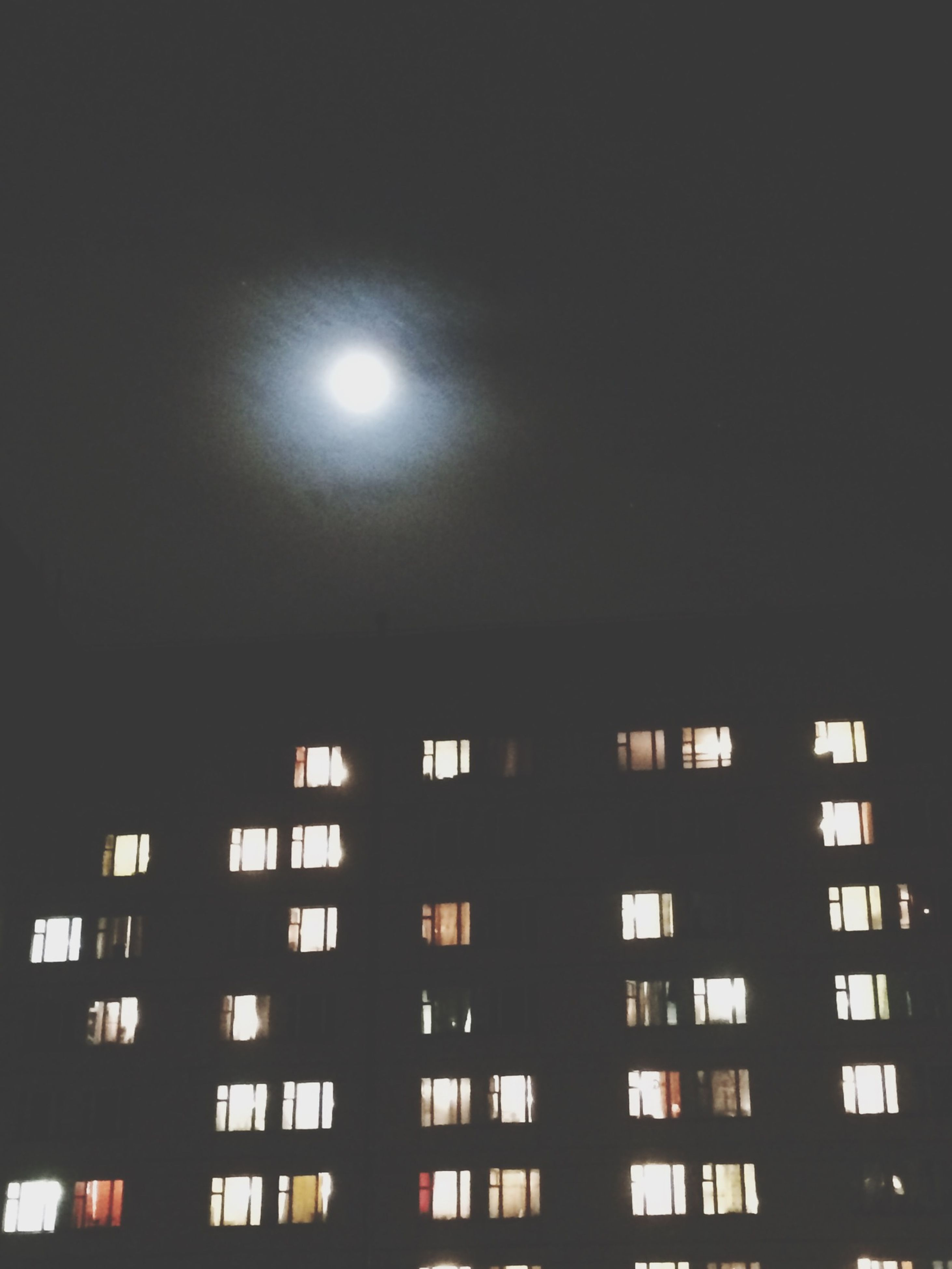 architecture, built structure, low angle view, building exterior, illuminated, window, night, building, lighting equipment, glass - material, residential building, city, sky, residential structure, no people, ceiling, dark, modern, outdoors, house