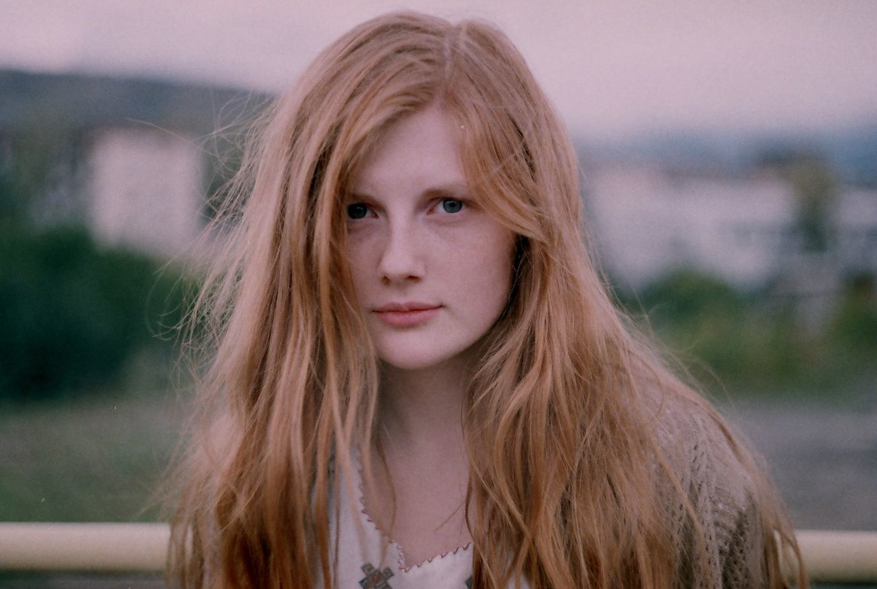 Analog Analogue Photography Blond Hair Close-up Day Film Film Photography Filmisnotdead Focus On Foreground Front View Headshot Long Hair Looking At Camera Nature One Person Outdoors Portrait Real People Redhead Young Adult Young Women Women Around The World