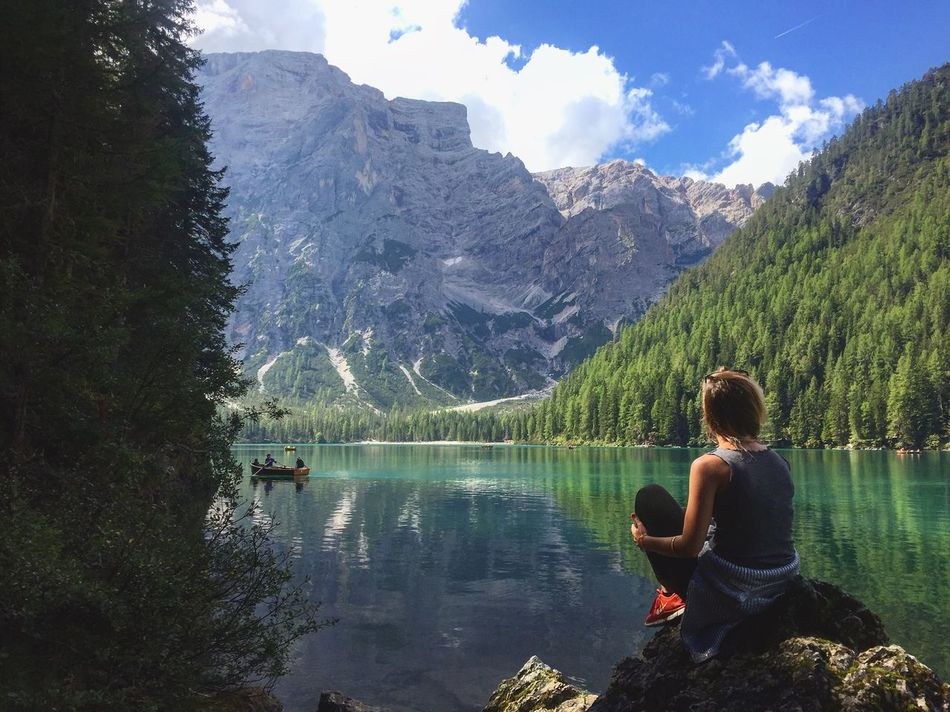 Never stop exploring Mountain Lake Water Leisure Activity Tranquil Scene Lifestyles Tranquility Scenics Tree Rear View Beauty In Nature Mountain Range Non-urban Scene Nature Casual Clothing Forest Cloud - Sky Tourist Full Length Tourism Trentino  Val Pusteria Never Stop Exploring People And Places