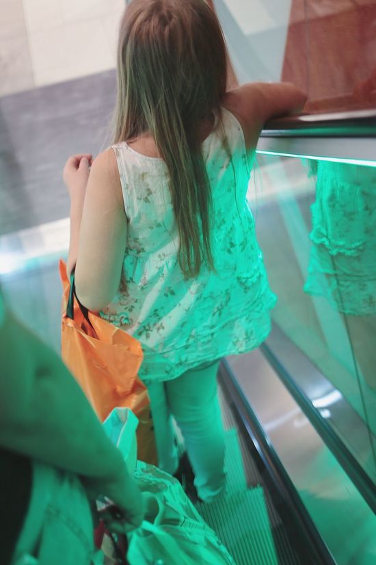 Girls Real People Indoors  One Person Childhood Lifestyles Day People Store Escalator Shopping Mall Full Frame Shopping Time Indoors  Indoor Young Adult Blond Hair Transportation Traveling Standing Casual Clothing Elementary Age Rear View Daughter Retail