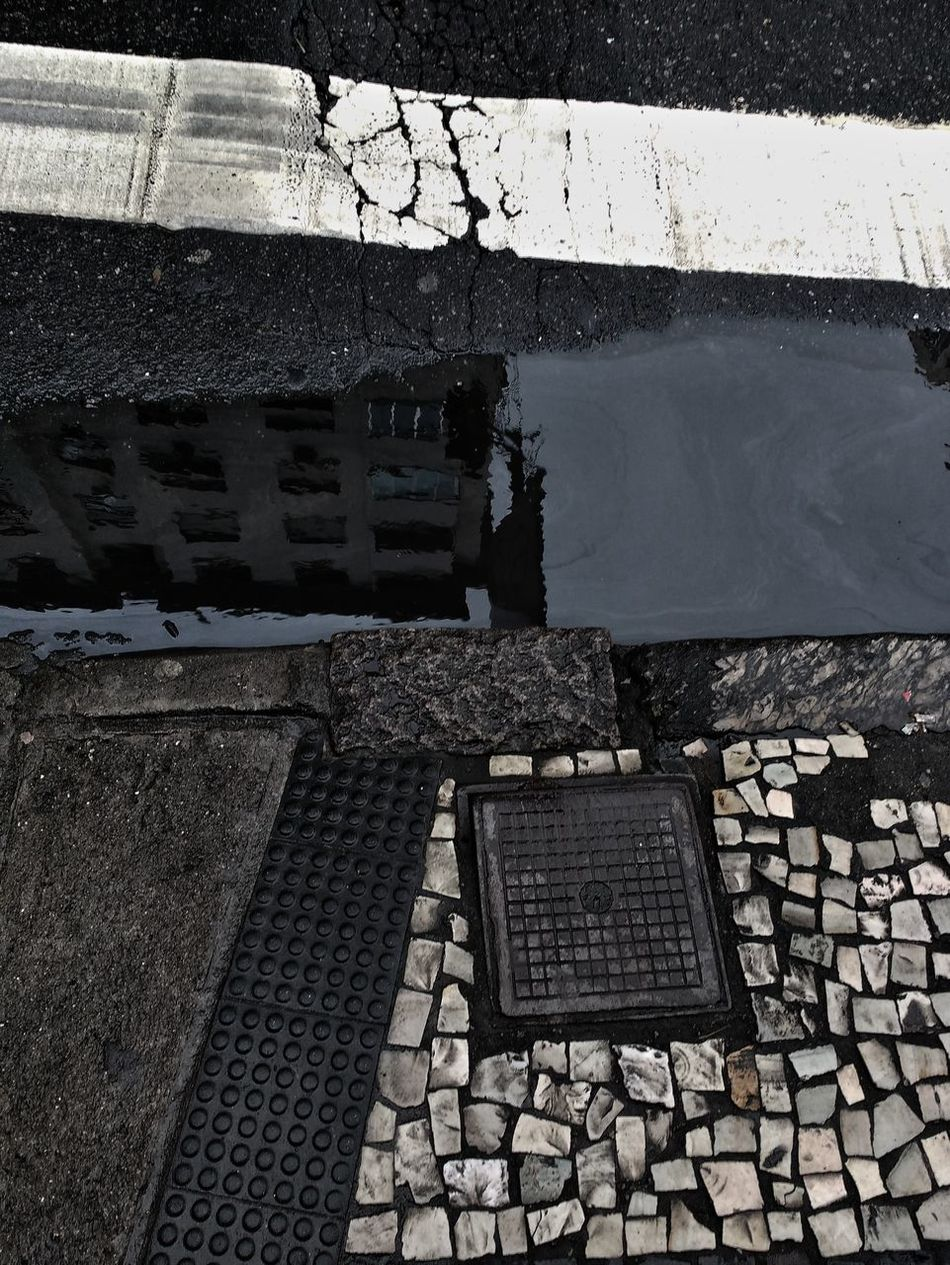 Pavement Puddle Reflection Sidewalk Road Road Markings Cracks Close-up Dirt Drain Drainage Street City Run Down Looking Down High Angle View Cracked Developing Country Third World Country Close Up Rain Drizzle Pavement Patterns Brazilian Water