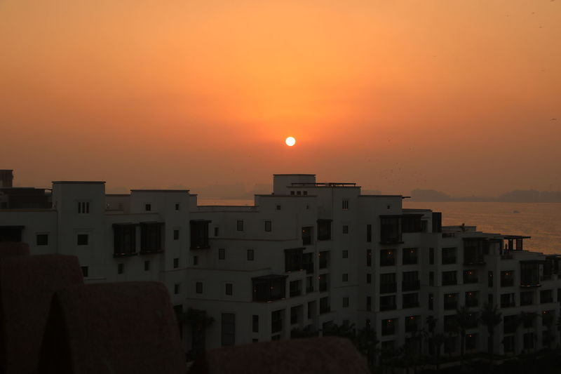 Sunset Burjalarab City Cityscape Day Dusk Nature No People Outdoors S Sea And Sky Seascape Seascape Photography Sky Skyviewers Sun Sunset Sunset_collection Urban Skyline View Wildwadi