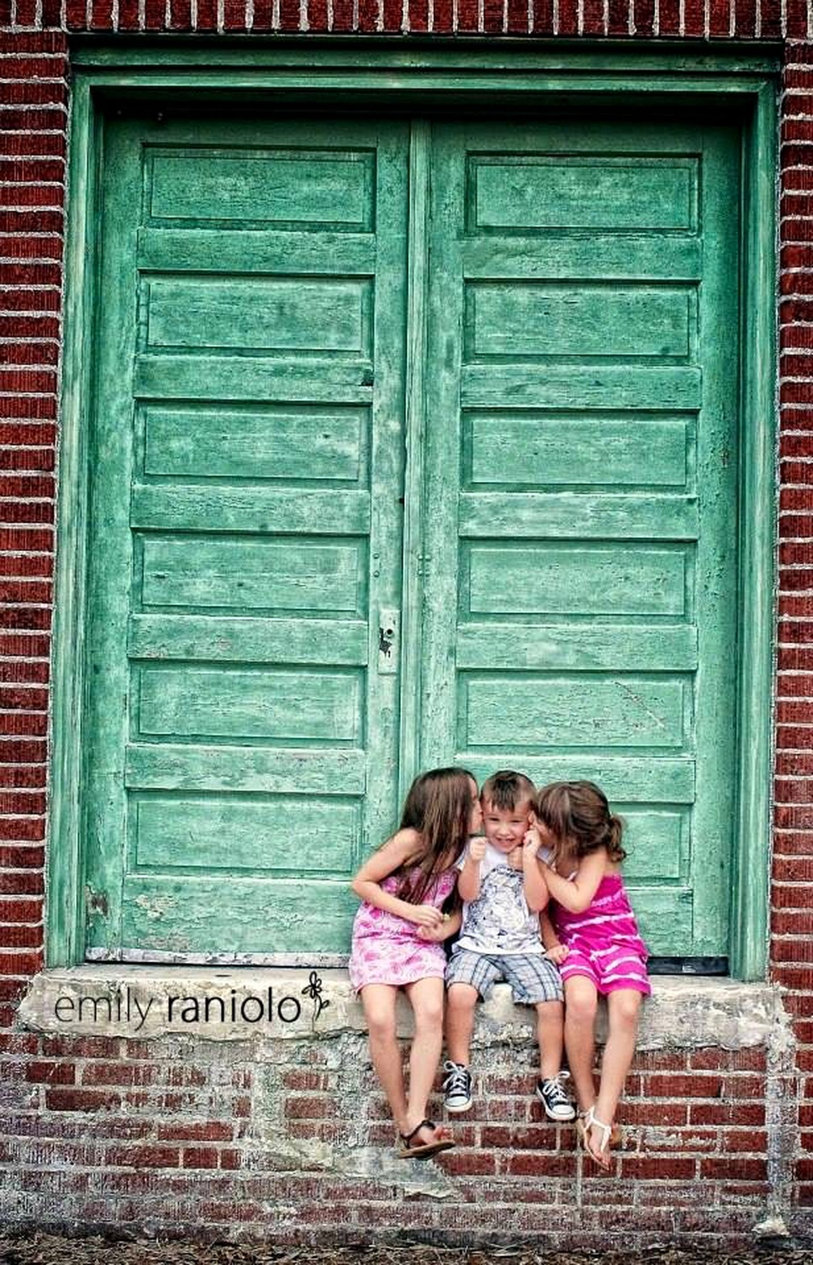 lifestyles, full length, casual clothing, leisure activity, built structure, architecture, building exterior, door, standing, rear view, wall - building feature, togetherness, person, wood - material, front view, love, childhood