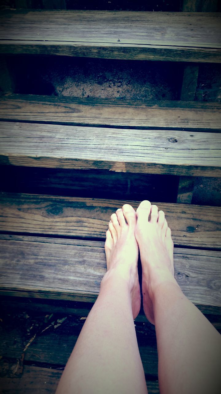 barefoot, human foot, low section, human leg, real people, human body part, one person, personal perspective, wood - material, leisure activity, day, women, outdoors, adult, people