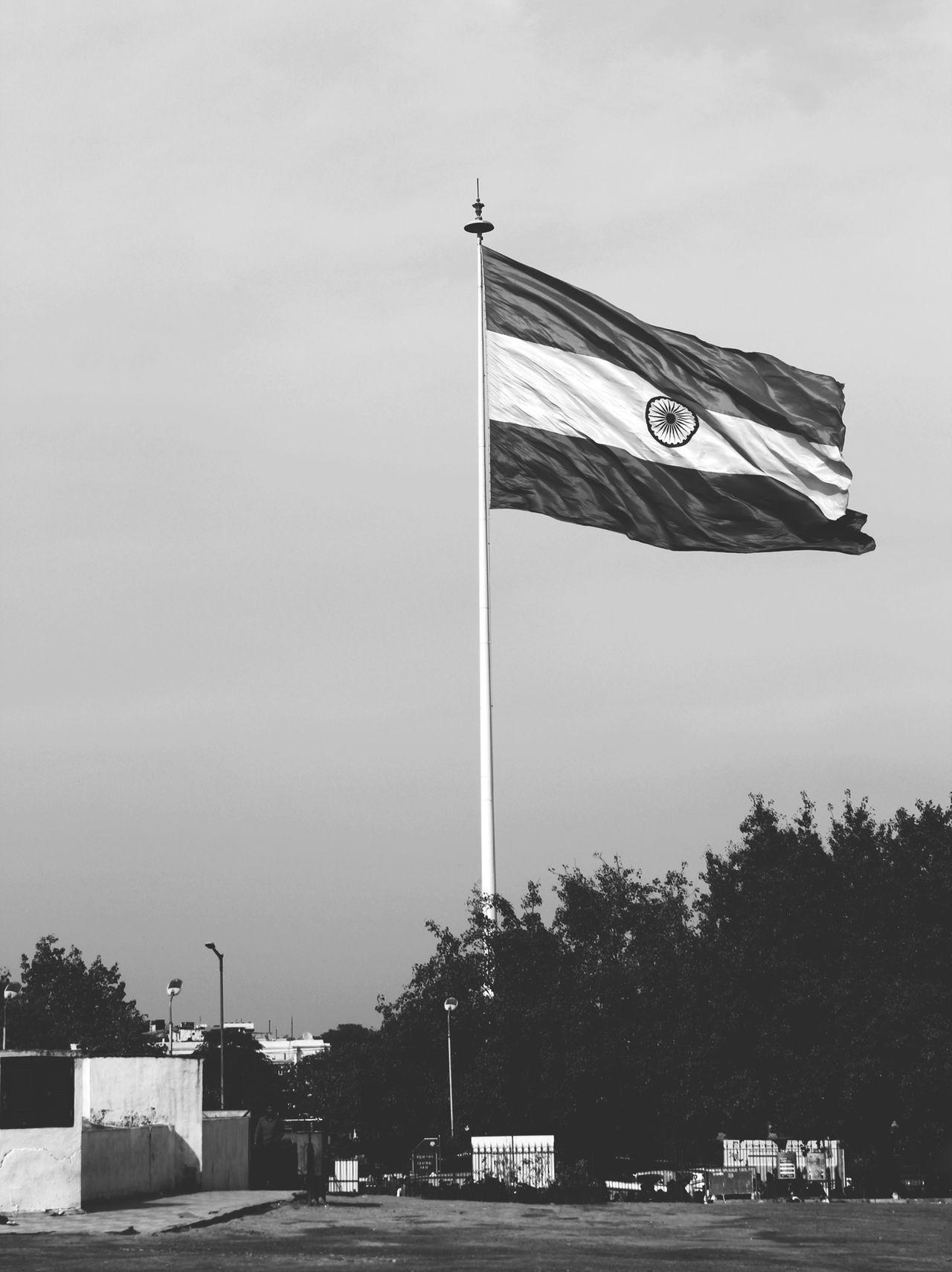 Indian Flag, fluttering in the wind, in the heart of India's capital city, New Delhi. Black & White Blackandwhite ConnaughtPlace Darktones Delhi Flag India Monochrome New Delhi Patriotism