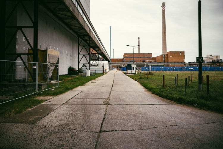 View to Block 1-4 at VEB Kombinat Kernkraftwerke Bruno Leuschner (old nuclear power plant Greifswald). Architecture Built Structure Cloud - Sky Day Diminishing Perspective Empty Energy Historic Industrial Industrial Landscapes No People Nopeople Nuclear Nuclear Power Plant Nuclear Reactor Old Buildings Outdoors Overcast Power Plant Sky The Way Forward Vanishing Point Way