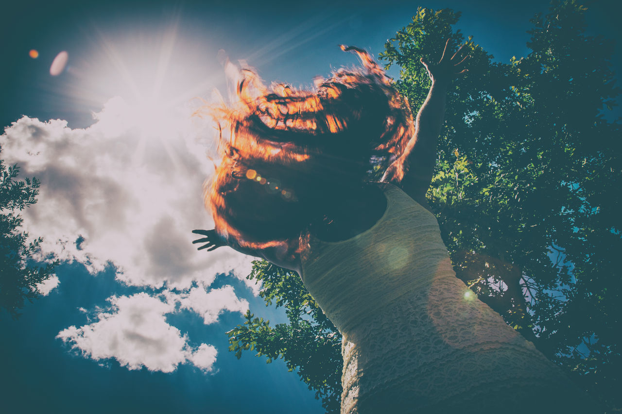 Alive  Day Energy Flying Hair Free Freedom Full Of Life Hair Light Magic Nature One Person Outdoors Person In Nature Reaching Redhead Sky Sunset Tree Woman