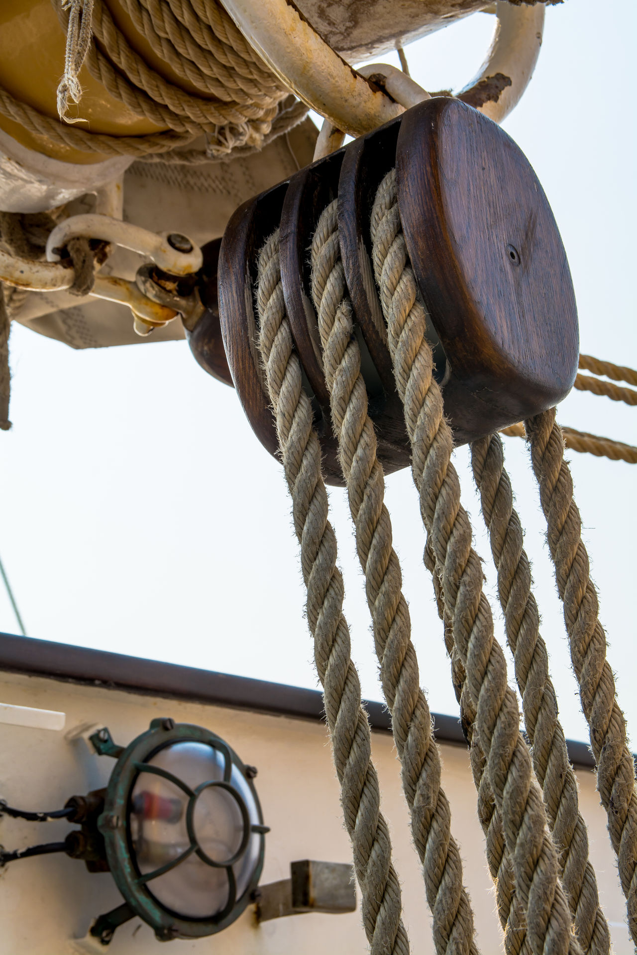 Architectural Feature Close-up Day Detail Light Lines Low Angle View Nautical Nautical Vessel No People Outdoors Part Of Perspective Pulley Ropes Sailing Ship Sails Sky Sunny Tall Ship Tool Triple Pulley Wooden