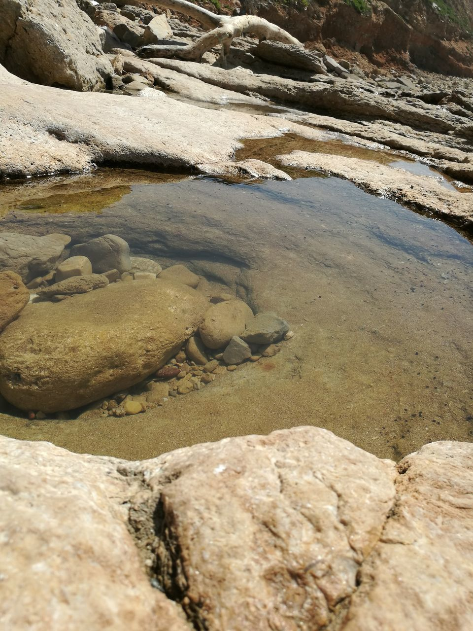nature, water, high angle view, sunlight, outdoors, no people, day, beauty in nature, hot spring