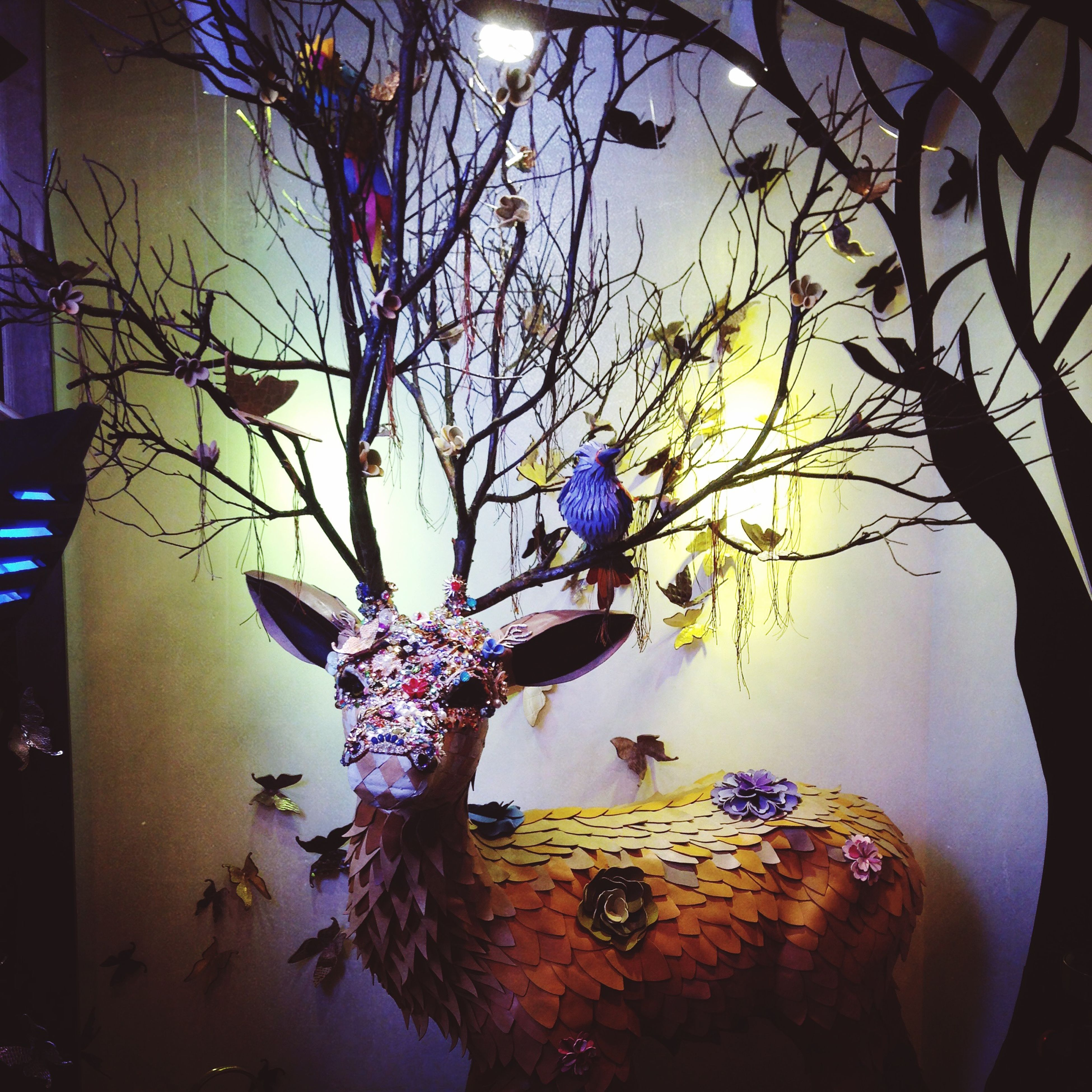illuminated, indoors, art, art and craft, decoration, creativity, lighting equipment, built structure, night, low angle view, architecture, blue, hanging, animal representation, multi colored, tree, branch, no people, wall - building feature, celebration
