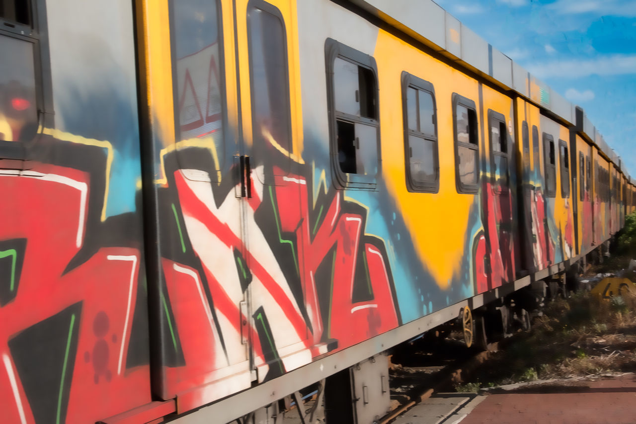 Cape Town Commuter Train Graffiti Art Land Vehicle Muizenberg Beach No People Public Transportation South Africa Transportation