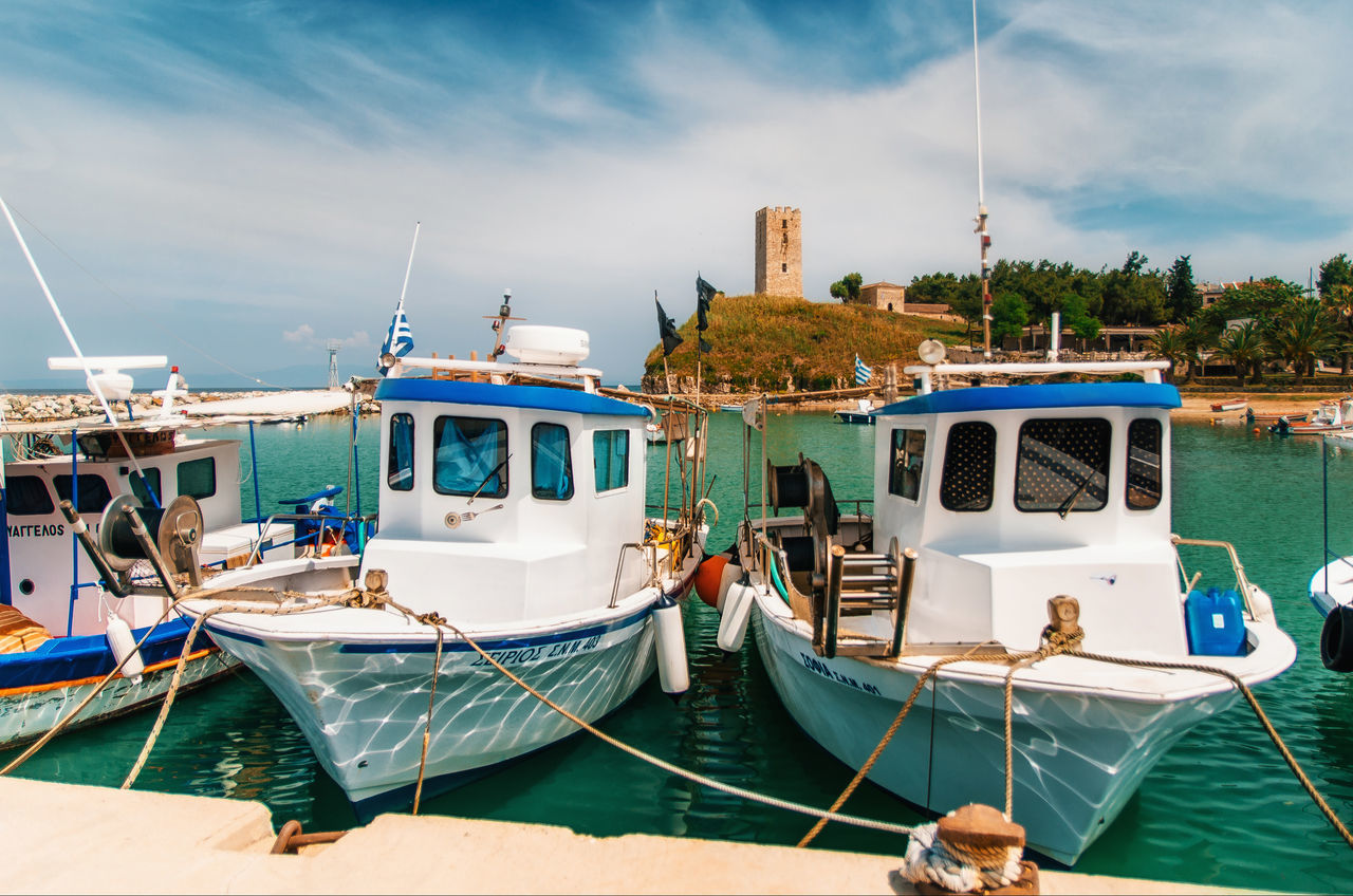 Boats in the background of Nea-Fokea Tower, Halkidiki Architecture Boat Chalkidiki Cloud - Sky Greece Halkidiki Lifestyles Marina Medieval Mode Of Transport Nautical Vessel Nea-Fo Outdoors Sailboat Sea Side By Side Tourism Tower Travel Traveling Vacations Water