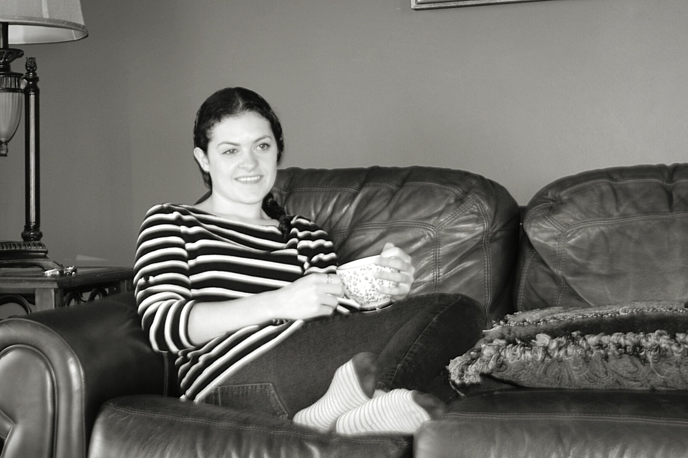 One Woman Only Sofa Adult Casual Clothing Looking At Camera One Person Living Room Portrait Leisure Activity Black & White Photography Black And White Portrait Black & White Tea Tea Time EyeEm Selects Close-up Smiling Woman Happy Woman Sitting Mature Adult Hands Hands Holding A Cup Relaxed Moments Relaxed Smile Woman Portraiture Black And White Friday
