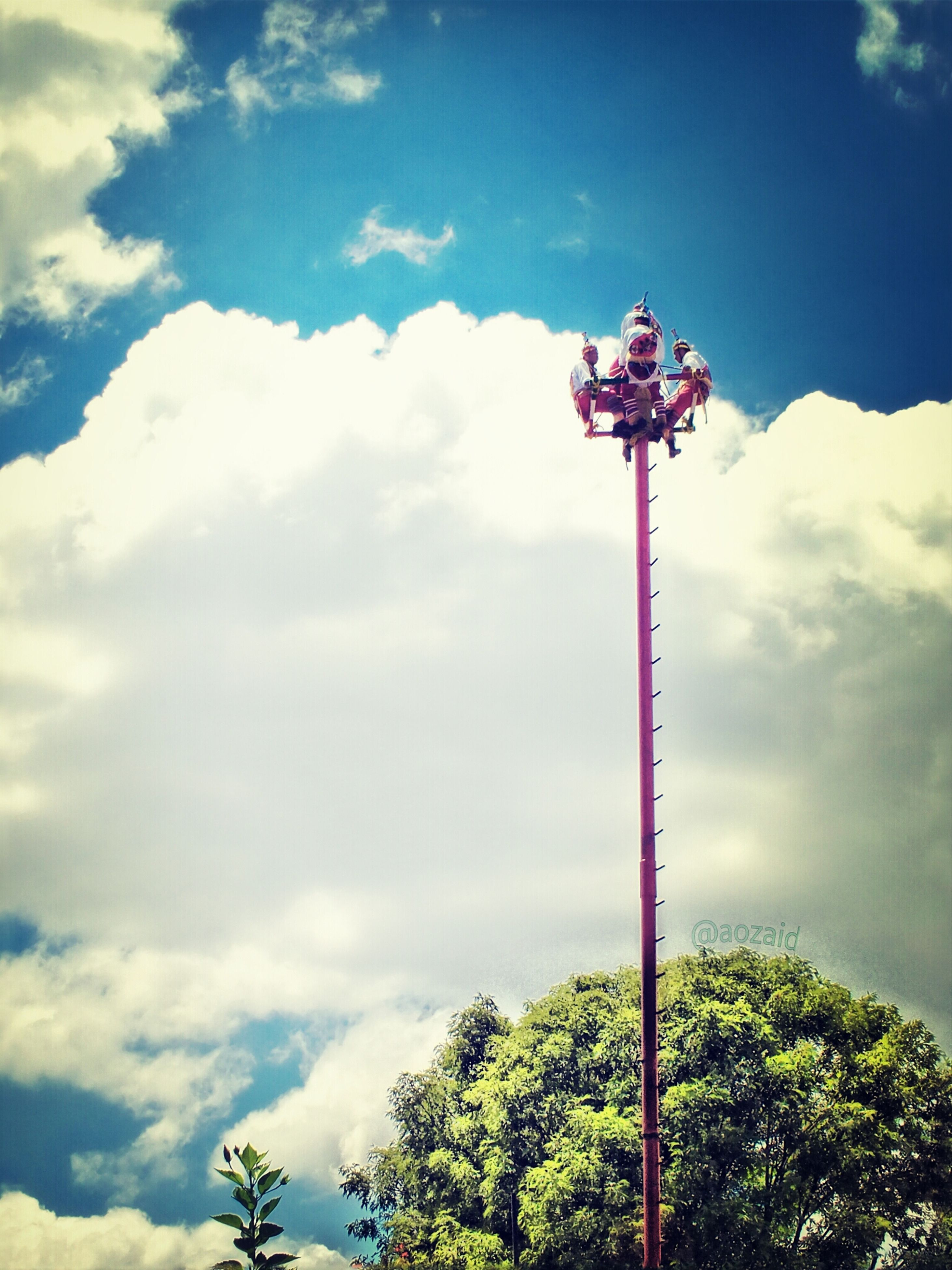 low angle view, sky, tree, cloud - sky, street light, cloud, cloudy, nature, lighting equipment, beauty in nature, tranquility, day, blue, pole, scenics, mountain, growth, outdoors, tranquil scene, no people
