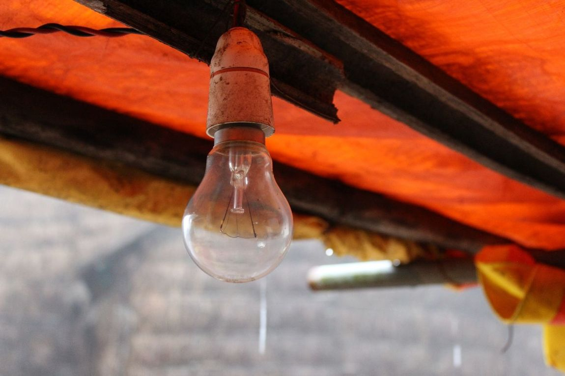 Drop Close-up Reflection No People Red Ceiling Light  Bulb Electric Lamp Electricity  No Power. :( Transparent Outdoors Photograpghy  Open Air Rainy Season RainyDay Wood Wooden Ceiling Temporary Ceiling
