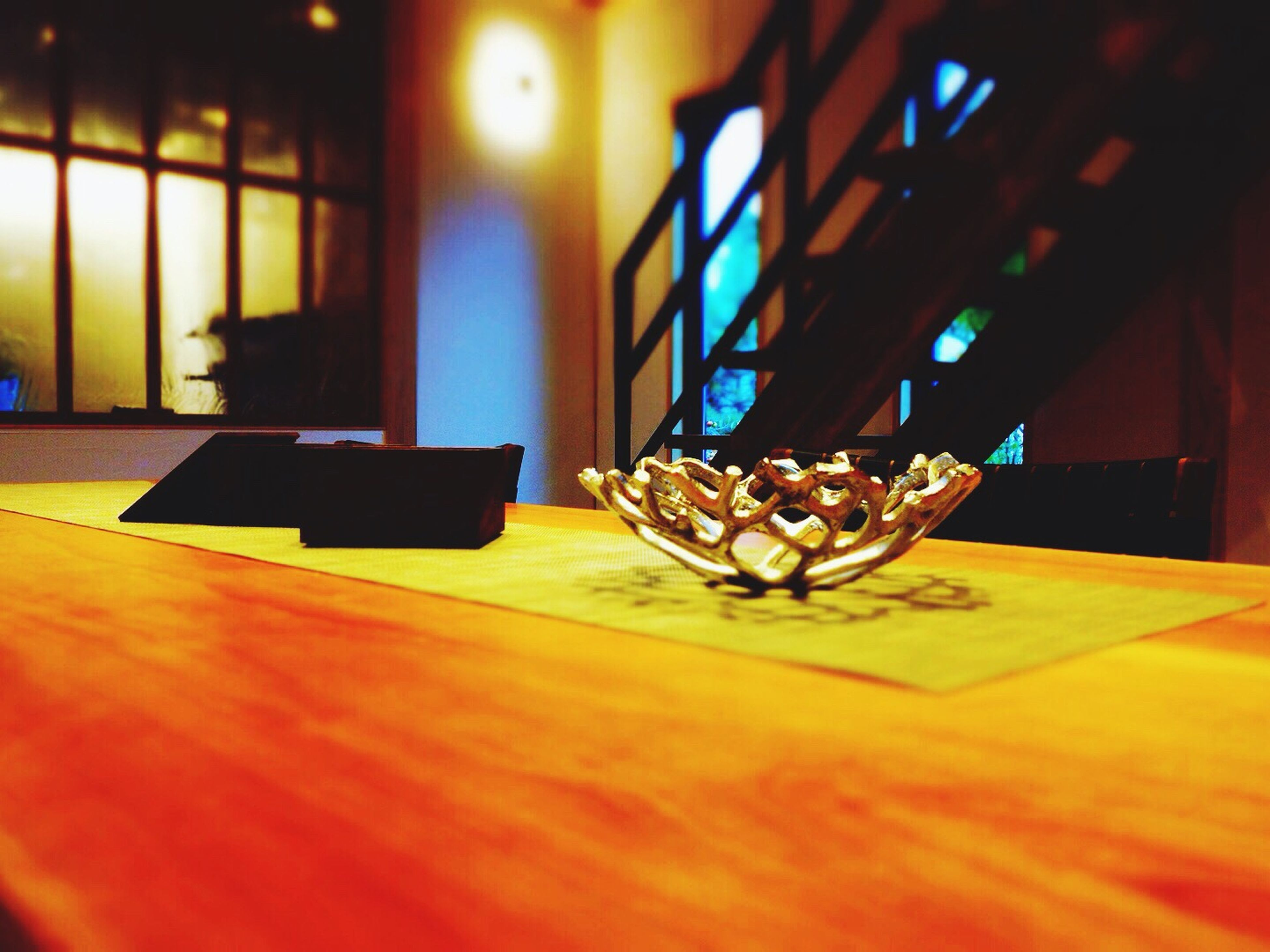 indoors, table, home interior, wood - material, still life, close-up, no people, focus on foreground, flooring, window, absence, sunlight, shadow, selective focus, hanging, empty, glass - material, hardwood floor, wooden, lighting equipment