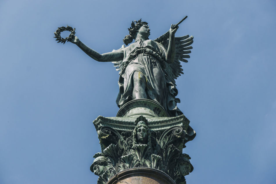 Close-up of statue of angel at Charlottenburg Palace in Berlin, Germany Angel Architecture Berlin Blue Charlottenburg Palace Clear Sky Close-up Color Image Day Germany🇩🇪 History Horizontal No People Outdoors Photography Sculpture Sky Statue Statue