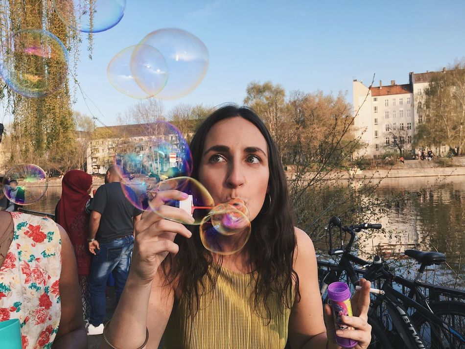 birthday girl Bubble Bubble Wand Young Adult Holding Leisure Activity Lifestyles Mid-air Day Real People Outdoors One Person