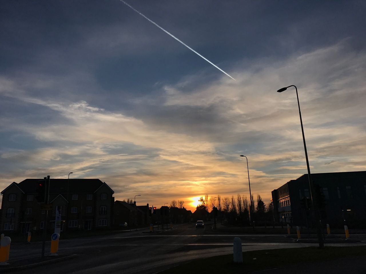 sunset, sky, built structure, street light, building exterior, cloud - sky, outdoors, architecture, vapor trail, no people, road, contrail, nature, city, day