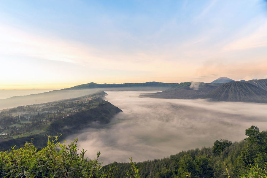 The Great Outdoors - 2016 EyeEm Awards Mountain View of Caldera of Bromo Tengger Semeru National Park with Fog at its Sandsea Plain . The Cemoro Lawang Village on the left with Mount Bromo slowly throwing her Volcanic Ash up in the Morning thin air A Bird's Eye View
