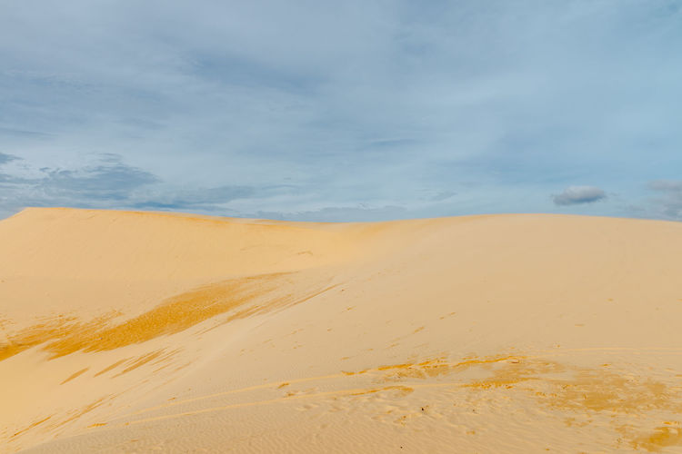 Sand dunes, Mui Ne South Vietnam Dec 2016 Arid Climate Beauty In Nature Cloud - Sky Day Desert Landscape Nature No People Outdoors Sand Sand Dune Scenics Sky Sky, Vietnam, Arabia, Backgrounds, Blue, Travel, City, Cultures, Desert, Dessert, Dry, Heat – Temperature, Horizontal, Journey, Landscape, No People, Pattern, Binh Thuan Province, Indochina, Land, Mui Ne Bay, Natural, Outdoors, Panoramic, Photography, Red Tranquil Scene Tranquility