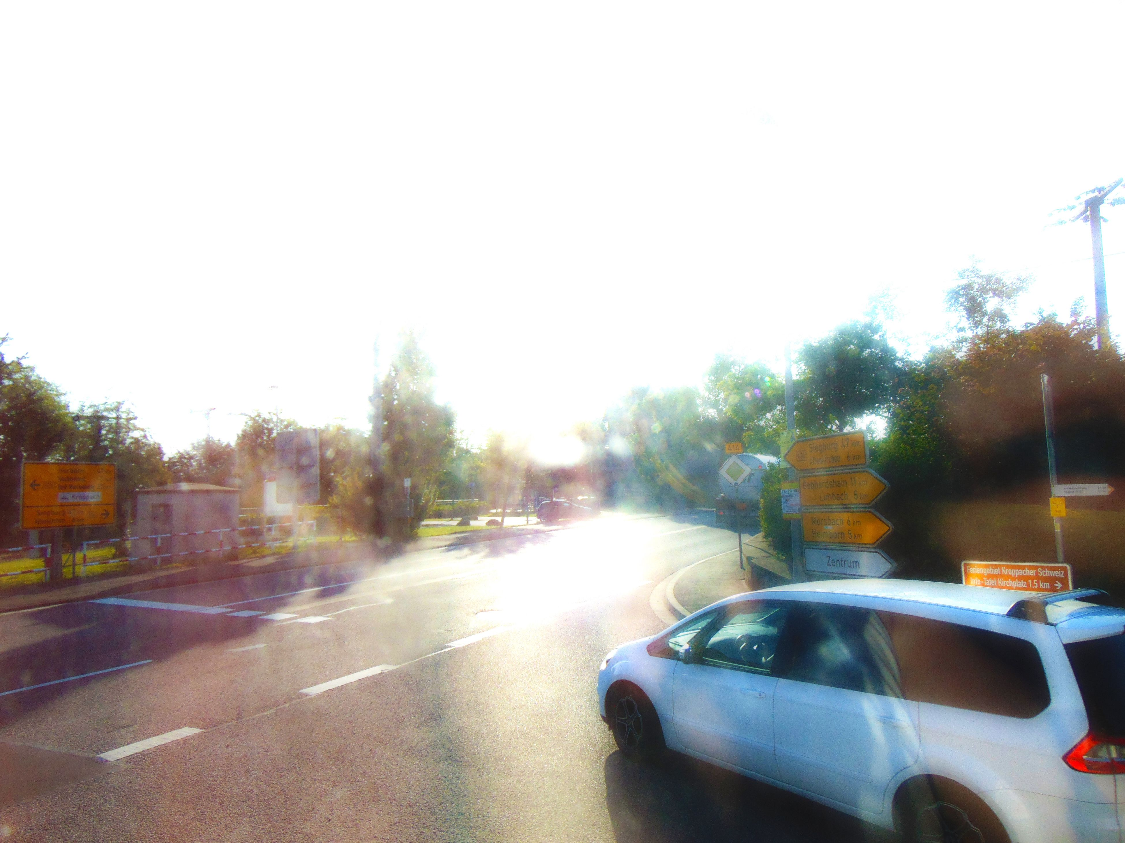 transportation, car, land vehicle, mode of transport, road, clear sky, street, tree, sun, road marking, sunlight, on the move, copy space, the way forward, traffic, lens flare, travel, sunset, windshield, vehicle