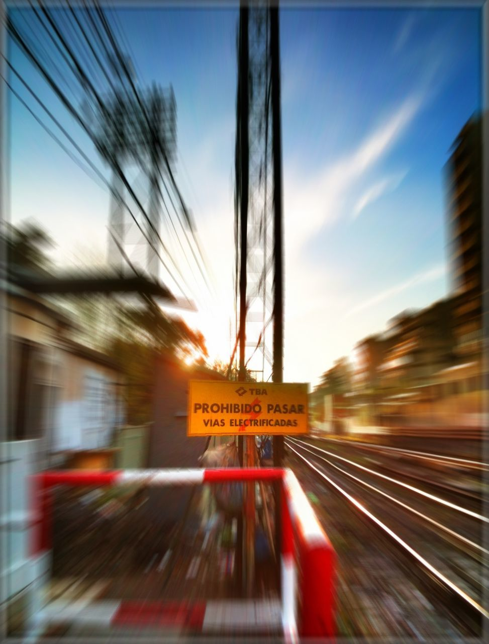 blurred motion, transportation, speed, motion, rail transportation, train - vehicle, railroad track, public transportation, sky, no people, mode of transport, communication, land vehicle, sunset, tree, outdoors, day, architecture, close-up