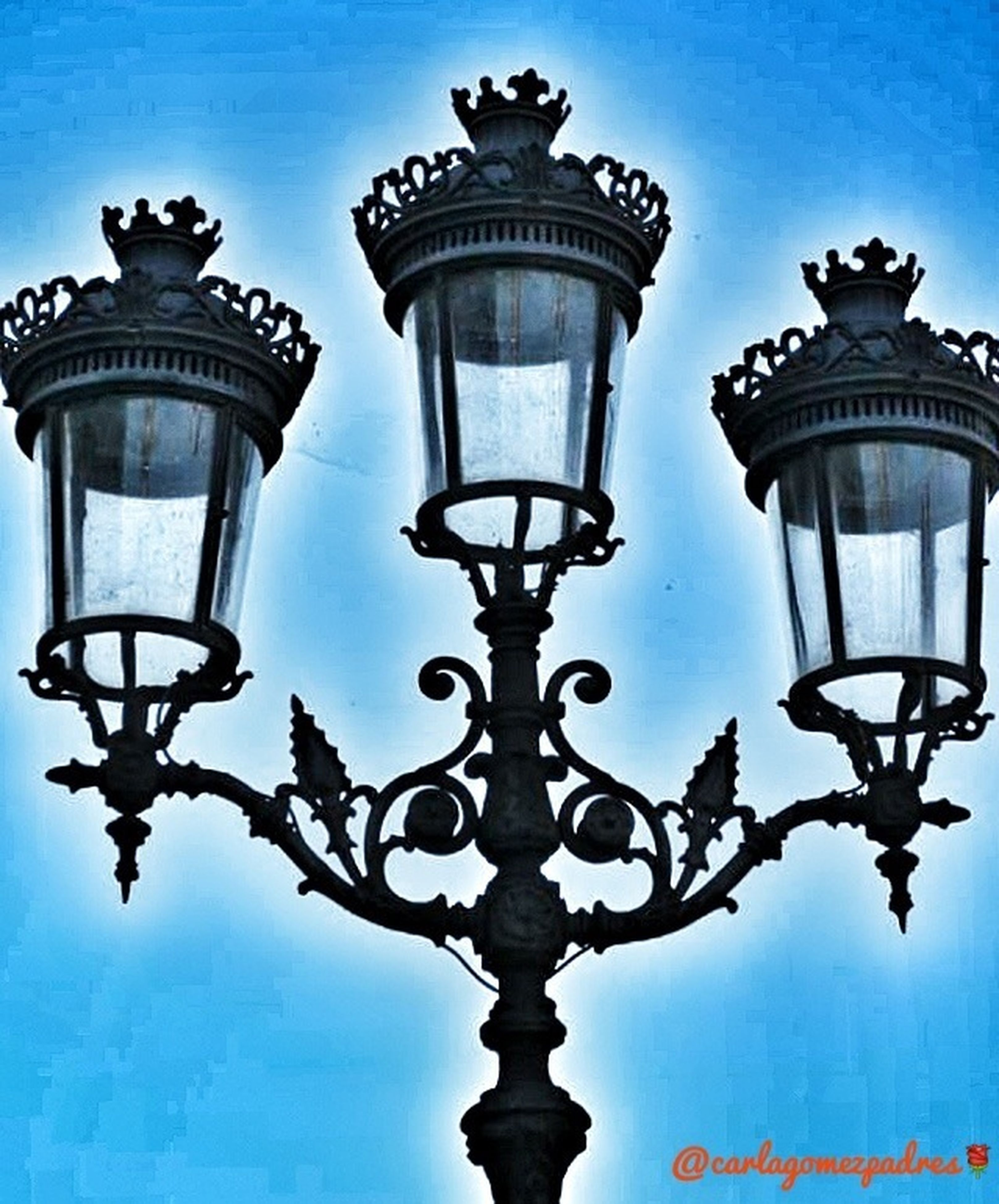 low angle view, lighting equipment, street light, built structure, architecture, sky, illuminated, blue, electric light, lamp post, building exterior, clear sky, electric lamp, high section, no people, dusk, outdoors, lantern, electricity, day