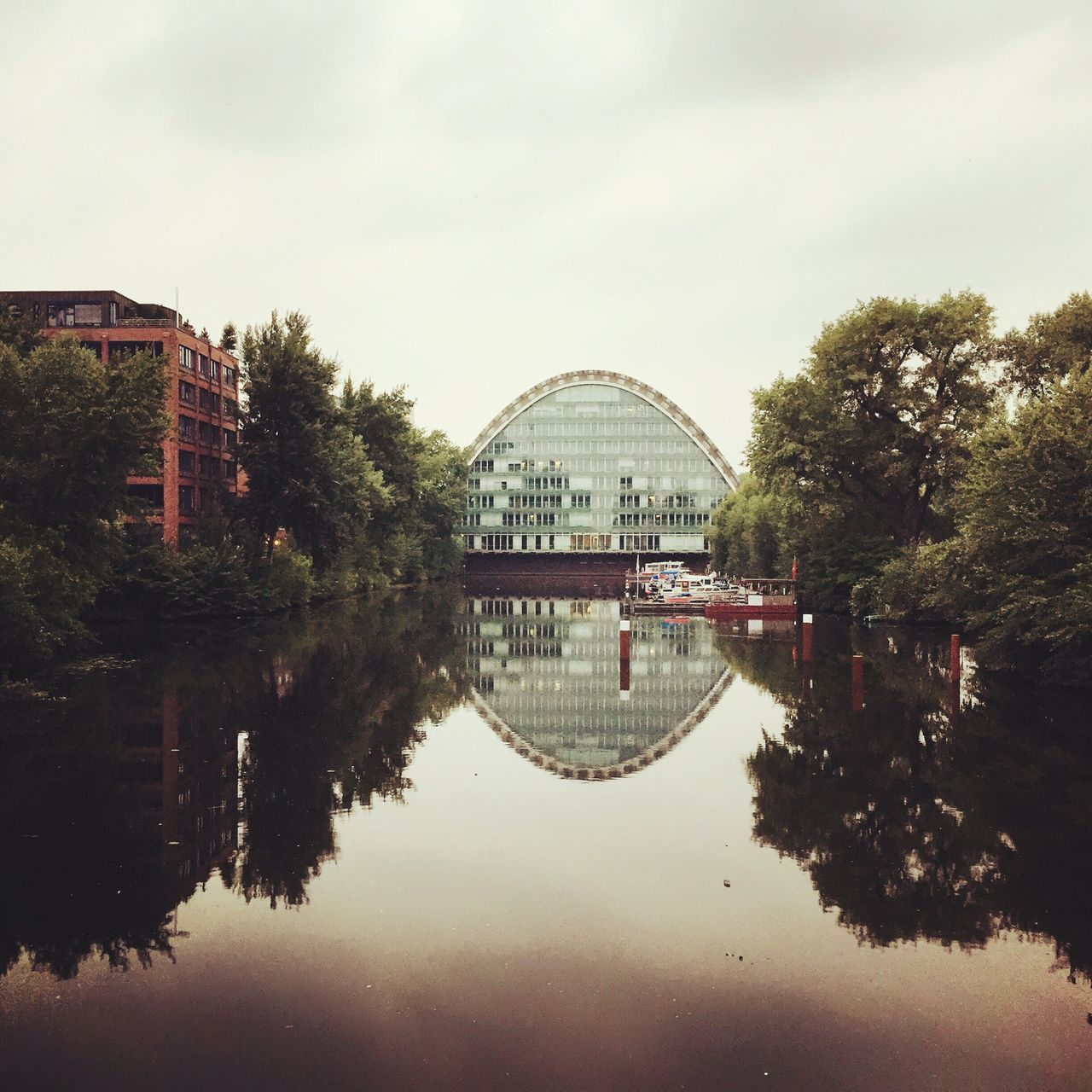 reflection, architecture, built structure, water, tree, building exterior, sky, city, no people, day, symmetry, outdoors, nature, cityscape