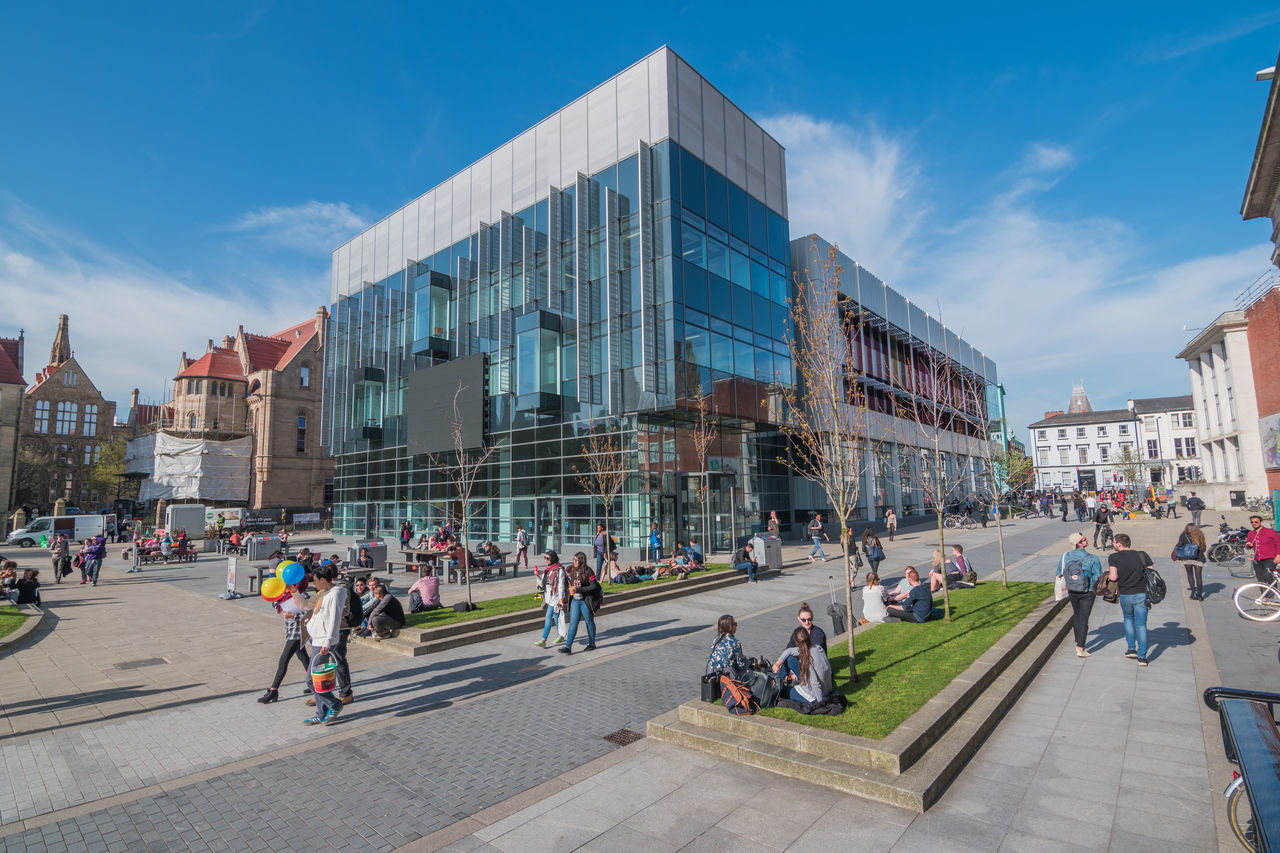 The Alan Gilbert Learning Commons of University of Manchester is a state of the art study and learning centre in the heart of the Oxford Road campus. Alan Architecture Building Exterior Built Structure City City Life Common Crowd Gilbert Large Group Of People Learning Lifestyles Light And Shadow Manchester Modern Oxford Road Student University View