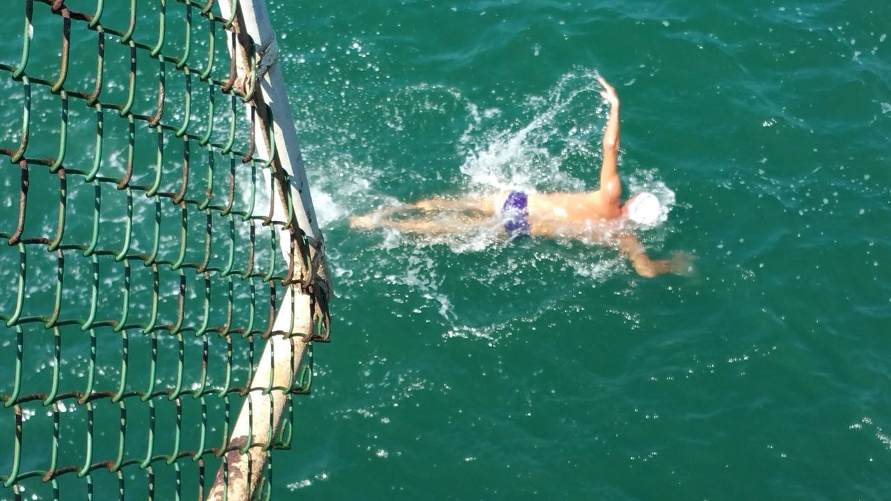 Swimmer In Race Ocean Race Competition Lifestyles Sport Water Swimming One Person Strength Aquatic Sport Athlete Check This Out EyeEm Best Shots - Nature Copy Space EyeEm Gallery Pattern Design Fine Art Photography Nature White Space Tranquil Scene Wave Sea High Angle View Backgrounds