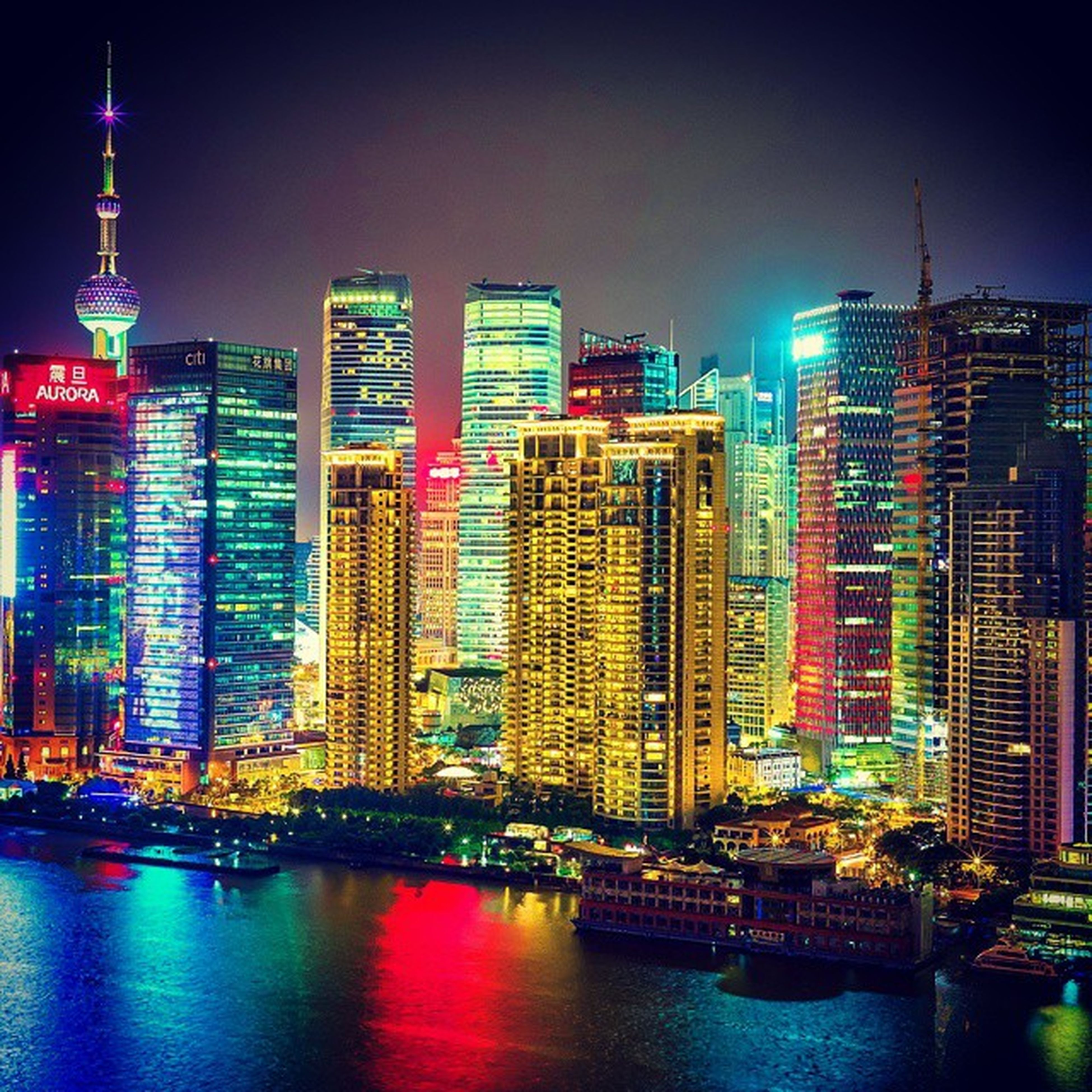 building exterior, architecture, city, built structure, skyscraper, illuminated, waterfront, tall - high, tower, water, cityscape, modern, office building, urban skyline, night, capital cities, river, financial district, travel destinations, famous place