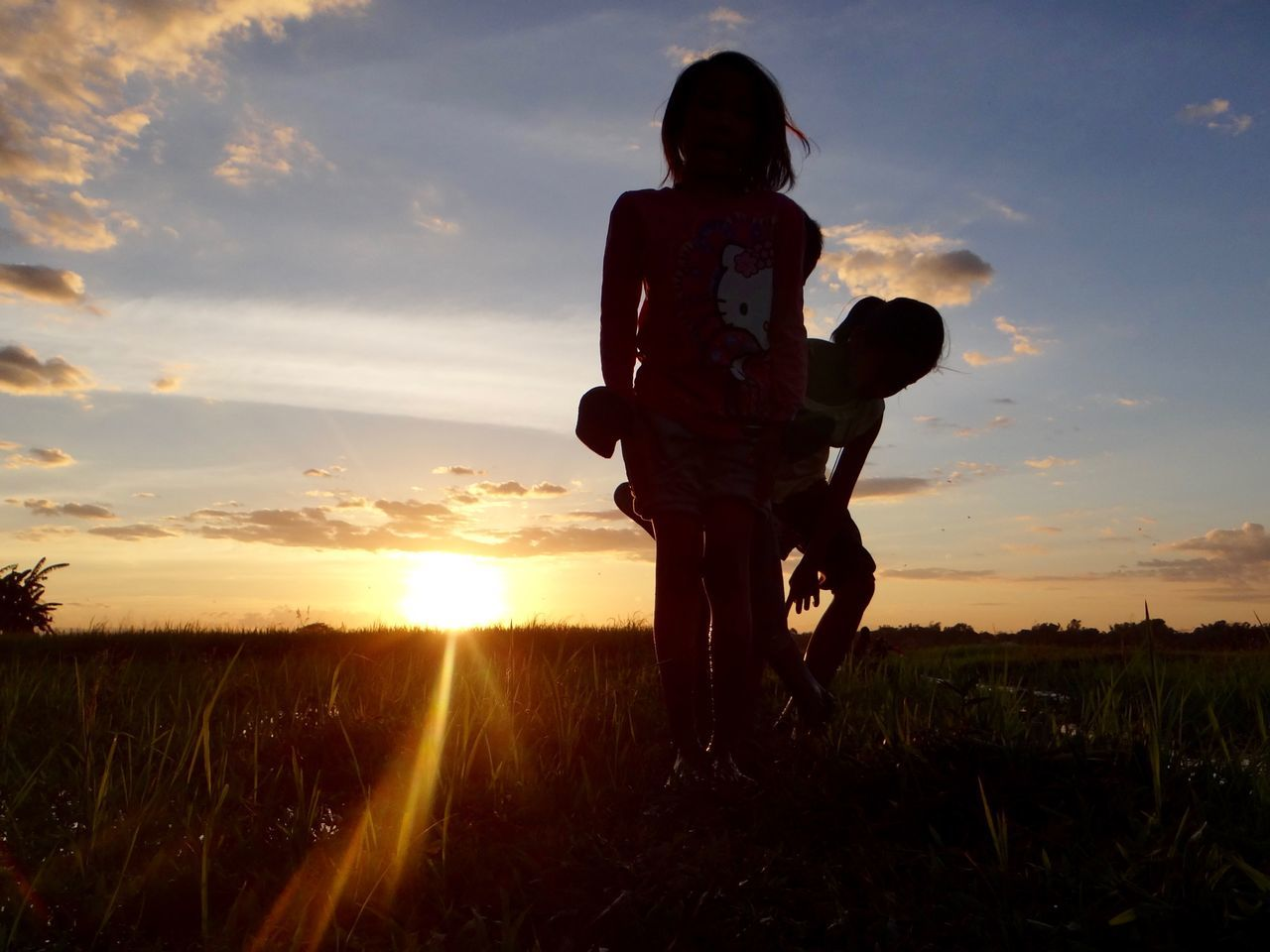 Childs play Beauty In Nature Child Children Field Nature Outdoors Sillouette Sky Sunset Sunset #sun #clouds #skylovers #sky #nature #beautifulinnature #naturalbeauty #photography #landscape
