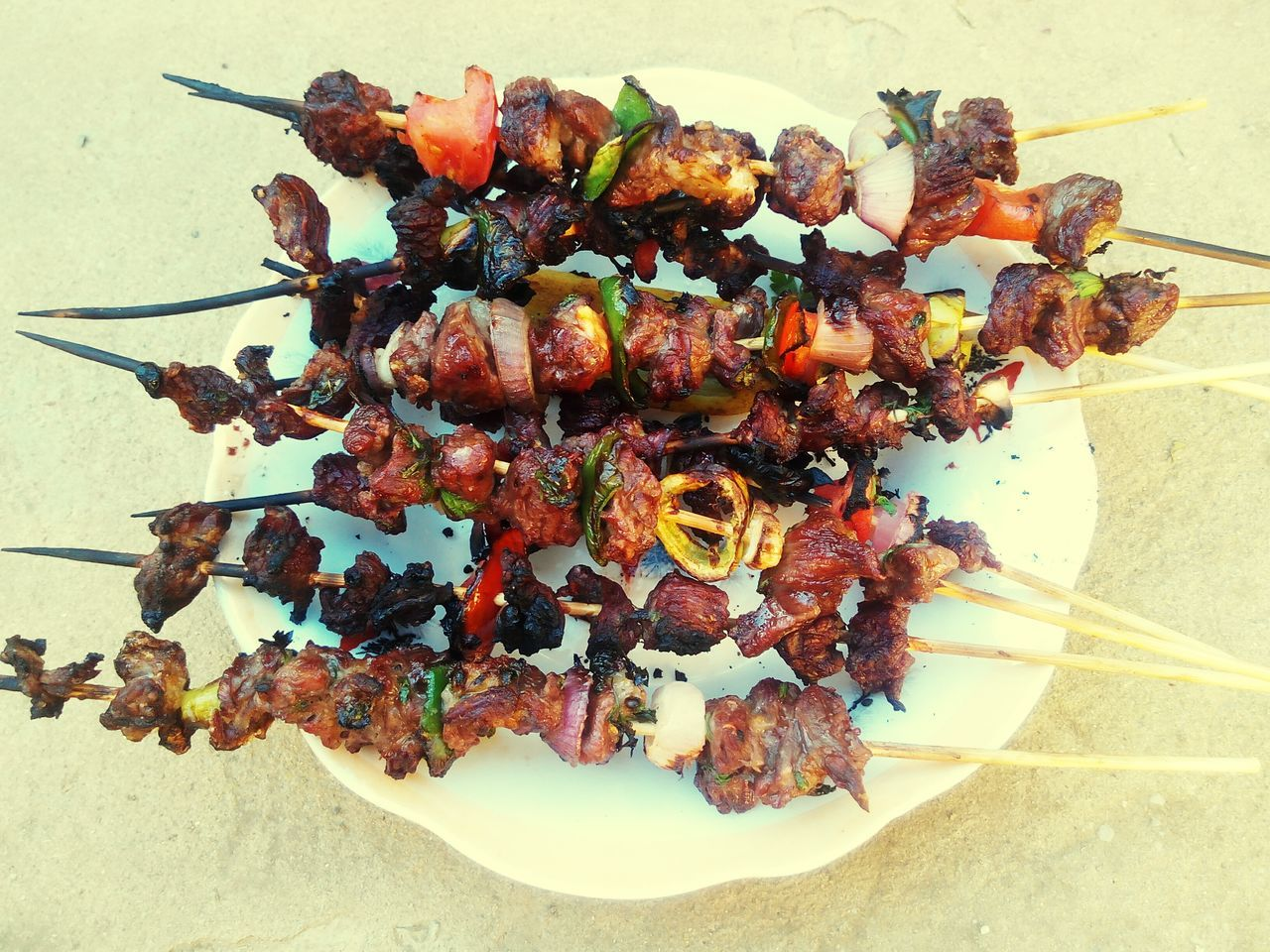 Close-Up Of Meat Skewers Served In Plate On Table