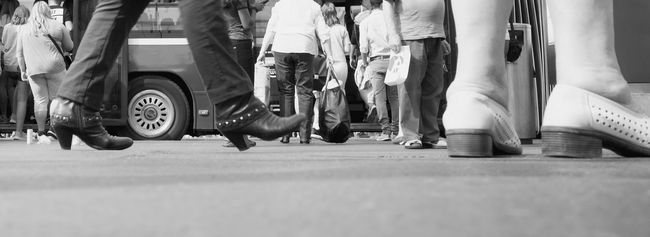 so many people are walking in the town, coming and going with their buses.....old and young Busstation Busy People City City Life Feet On The Ground From My Point Of View Group Of People Low Angle Shot Low Angle View Low Section On The Street Person Ricohgr2 Selective Focus Street