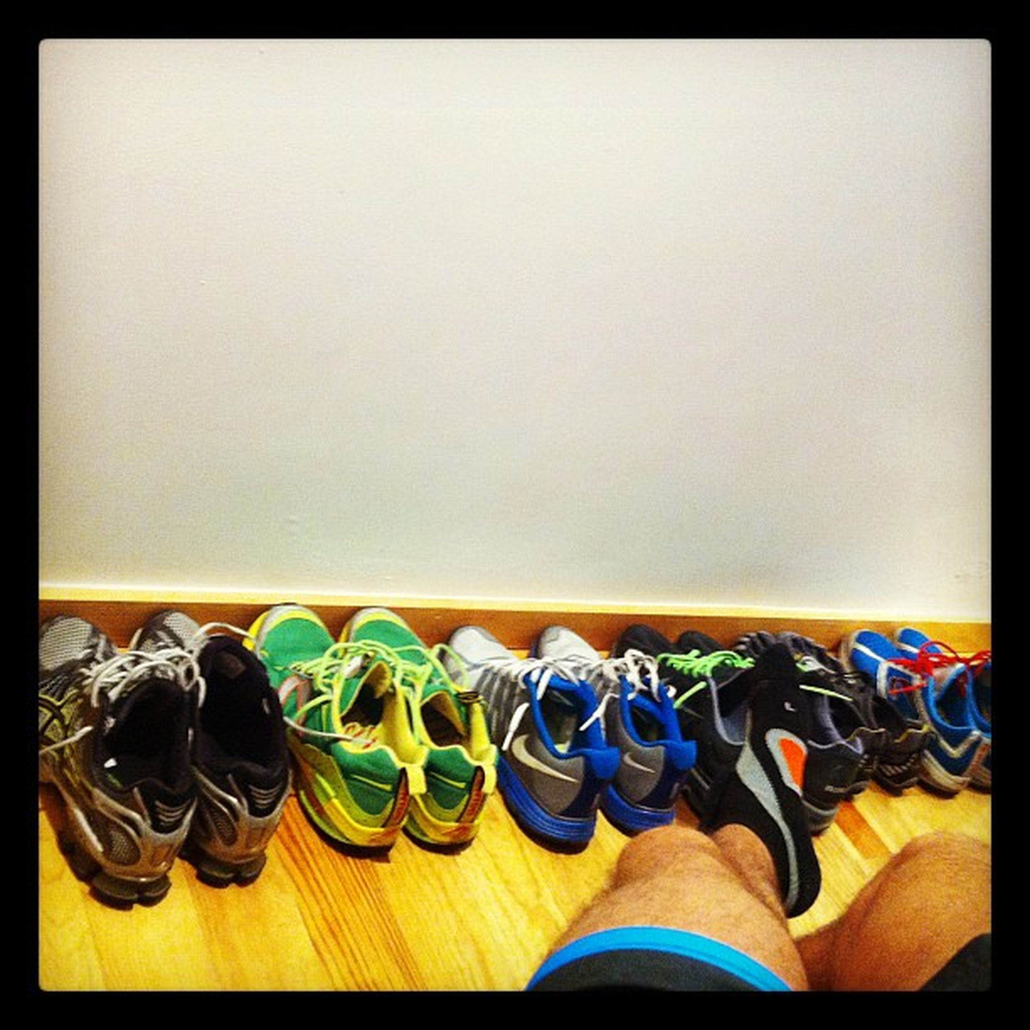 indoors, copy space, transfer print, auto post production filter, multi colored, large group of objects, arrangement, still life, table, in a row, variation, shoe, flooring, absence, wall - building feature, side by side, wood - material, choice, order, wall