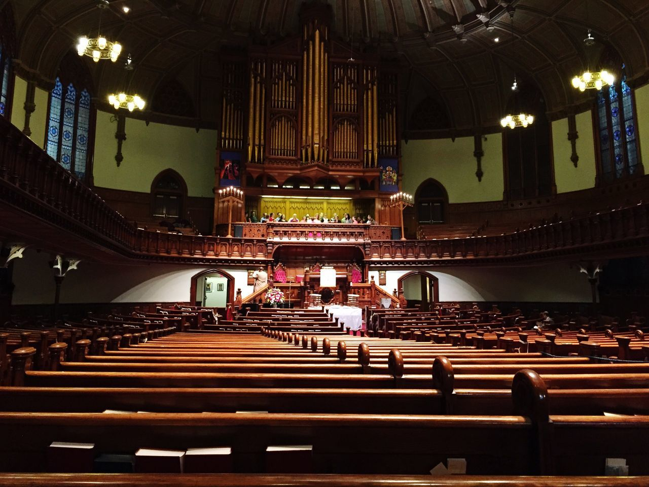 music, indoors, arts culture and entertainment, real people, architecture, sitting, pew, built structure, men, auditorium, audience, large group of people, seat, concert hall, musical instrument, day, people