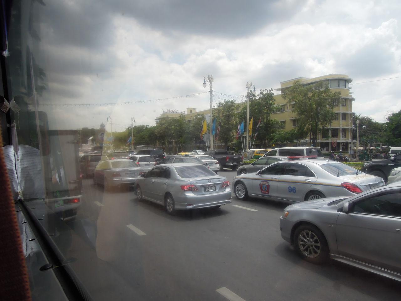 bus window photo on the road in bangkok Bangkok Bus Bus View Bus Window Car City City Life Metropolis Road Street Thailand Traffic Traffic Jam View