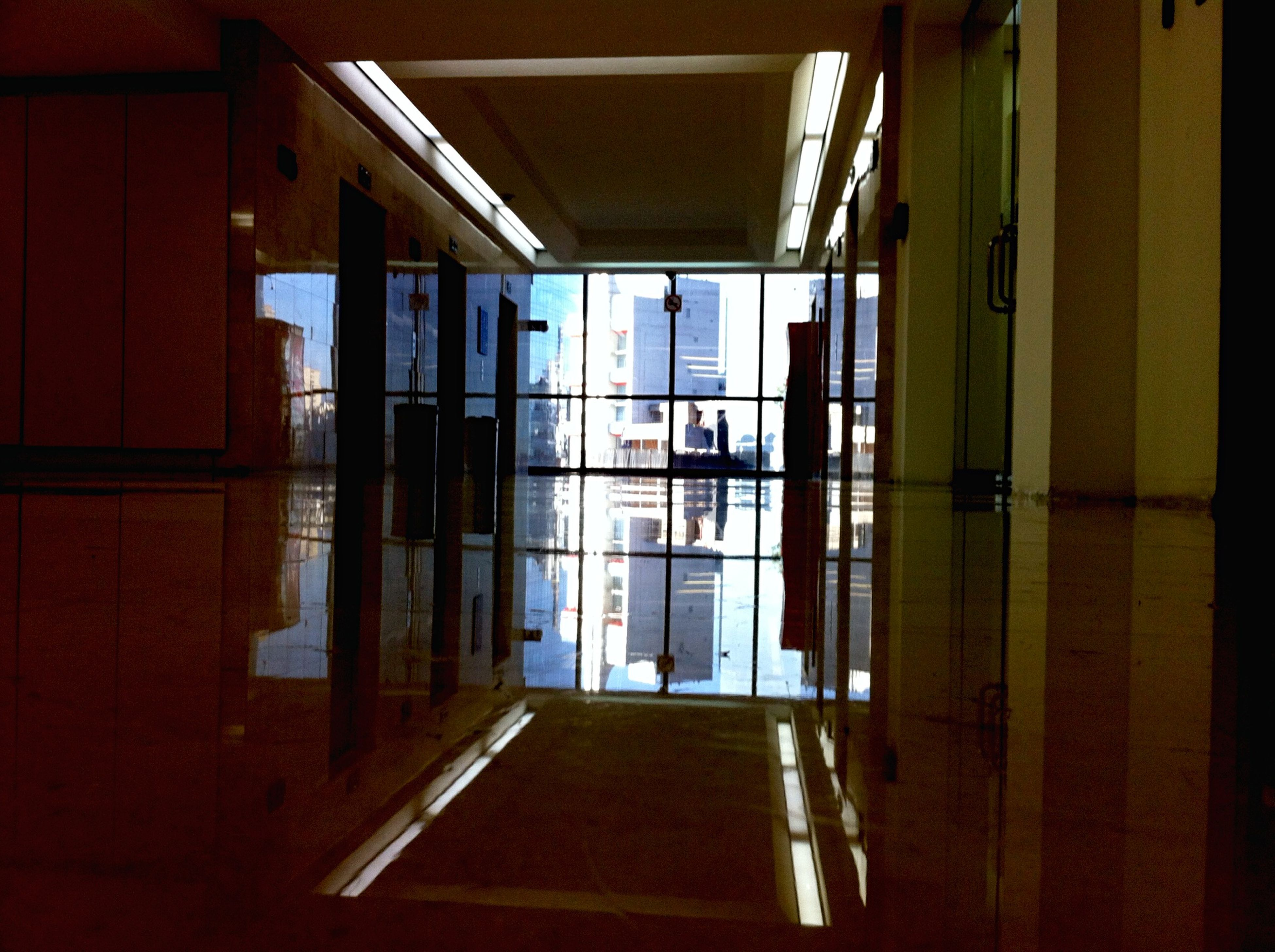 indoors, architecture, window, built structure, glass - material, reflection, transparent, house, building, building exterior, flooring, door, shadow, ceiling, sunlight, day, empty, no people, corridor, residential structure