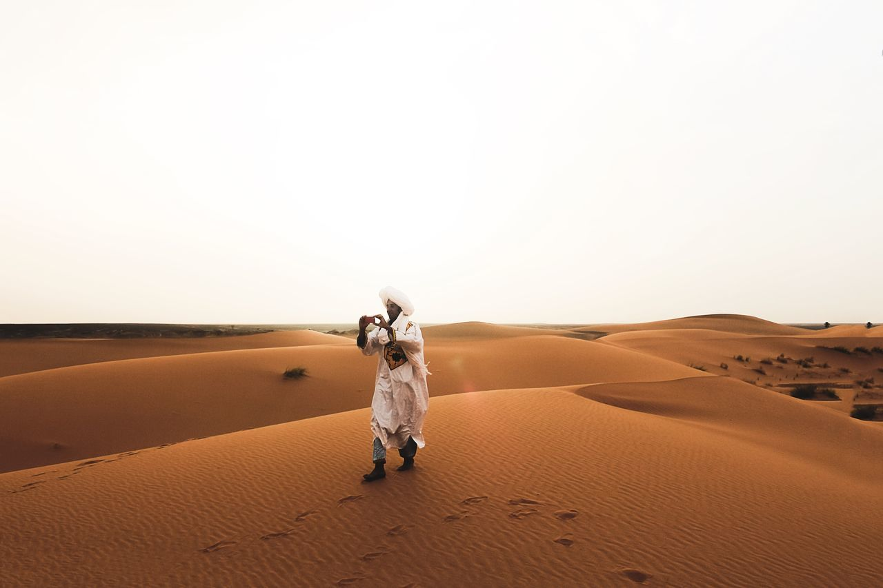 Desert Sand Full Length One Person Sand Dune Arid Climate Clear Sky Outdoors Beach People Astronaut Nature Futuristic Day Erg Chebbi Maroc Morocco