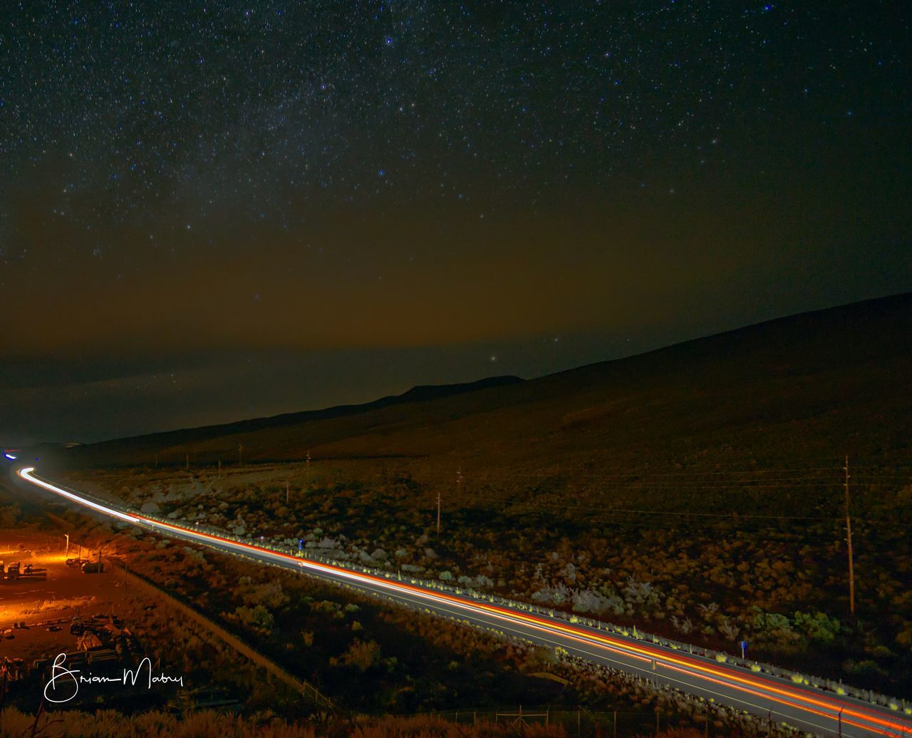 transportation, road, night, landscape, scenics, sky, mode of transport, outdoors, railroad track, no people, the way forward, nature, beauty in nature, tranquility, mountain, star - space, astronomy