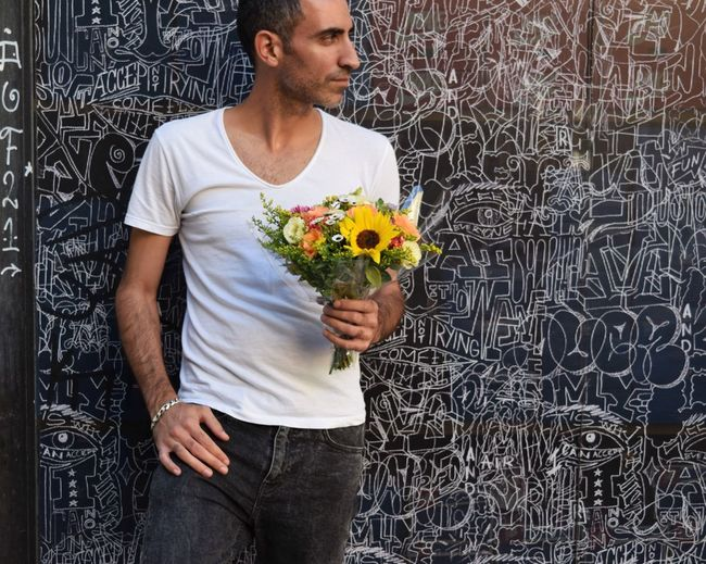 Portrait Flower Adults Only Holding Front View One Person Adult People One Man Only Profile Outdoors Groom Wedding Celebration Portrait Of A Man  Standing Tel Aviv Handsome Bouquet Bouquet Of Flowers Fashion Stylish Manly  Fashion Photography Wall