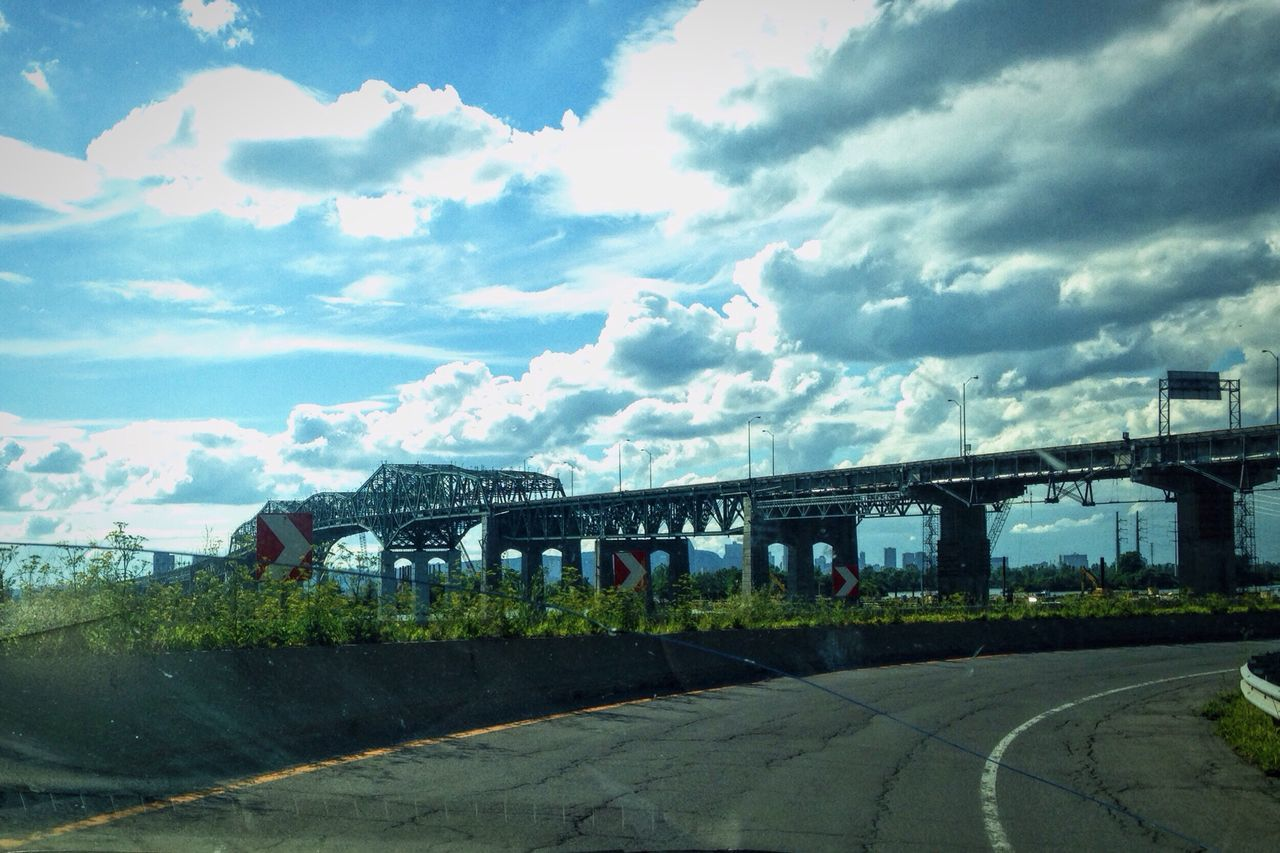 architecture, sky, connection, cloud - sky, built structure, transportation, bridge - man made structure, road, no people, outdoors, day, building exterior, nature